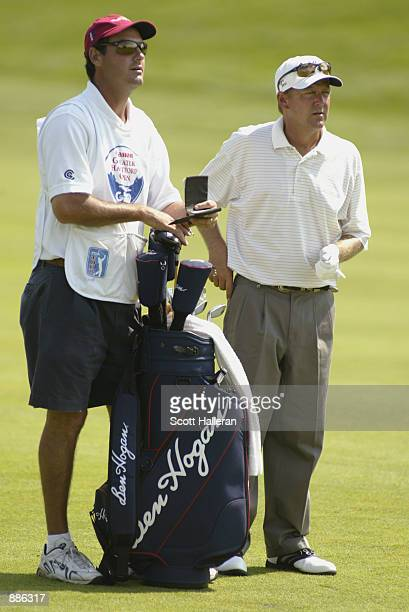 Mark Brooks looks over a shot during Wednesday's proam at the Canon Greater Hartford Open on June 19 2002 at TPC River Highlands in Cromwell...