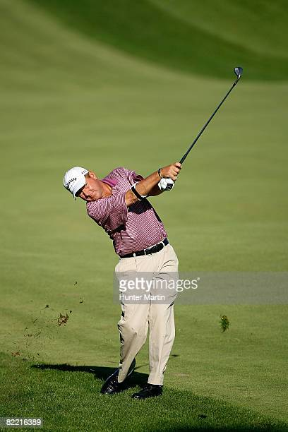 Mark Brooks plays his second shot on the first hole during round two of the 90th PGA Championship at Oakland Hills Country Club on August 8 2008 in...