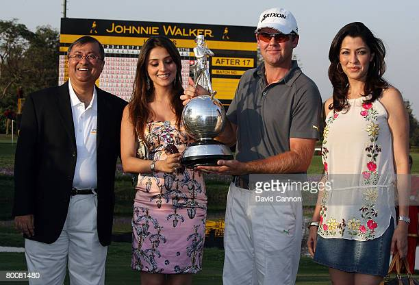 Mark Brown of New Zealand holds the trophy with Mr Asif Adil the MD of Diageo India Bollywood actress Aarti Chhabria and another Bollywood actress...