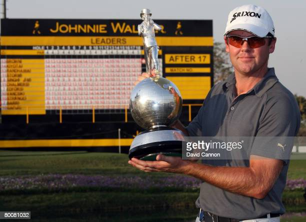 Mark Brown of New Zealand poses with the trophy after winning the final round of the 2008 Johnnie Walker Classic held at The DLF Golf and Country...
