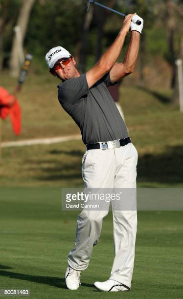Mark Brown of New Zealand thins his second shot to the 18th green during the final round of the 2008 Johnnie Walker Classic held at The DLF Golf and...