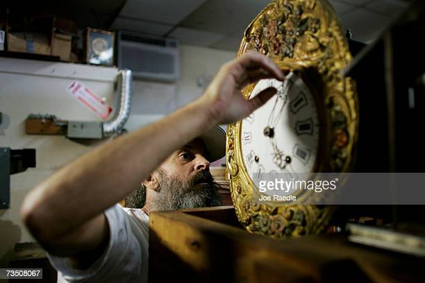 Mark Brown repairs a clock at Browns Old Time Clock Shop March 6 2007 in Plantation Florida This year day light savings time happens three weeks...