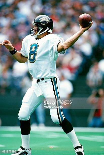 Mark Brunell of the Jacksonville Jaguars drops back to pass against the Cincinnati Bengals during an NFL football game October 27 1996 at Cinergy...