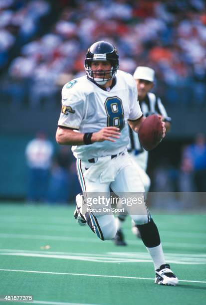 Mark Brunell of the Jacksonville Jaguars scrambles with the ball against the Cincinnati Bengals during an NFL football game October 27 1996 at...