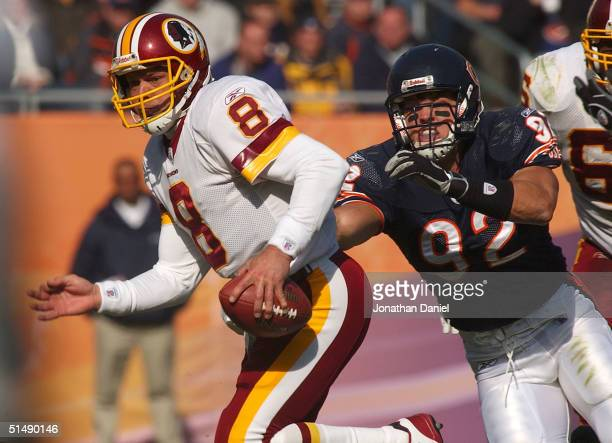 Mark Brunell of the Washington Redskins is chased out of the pocket by Hunter Hillenmeyer of the Chicago Bears during a game at Soldier Field October...