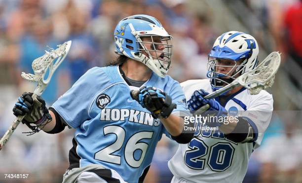 Mark Bryan of Johns Hopkins gets checked by Steve Schoeffel of Duke on May 28 2007 at MT Bank Stadium in Baltimore Maryland Johns Hopkins University...