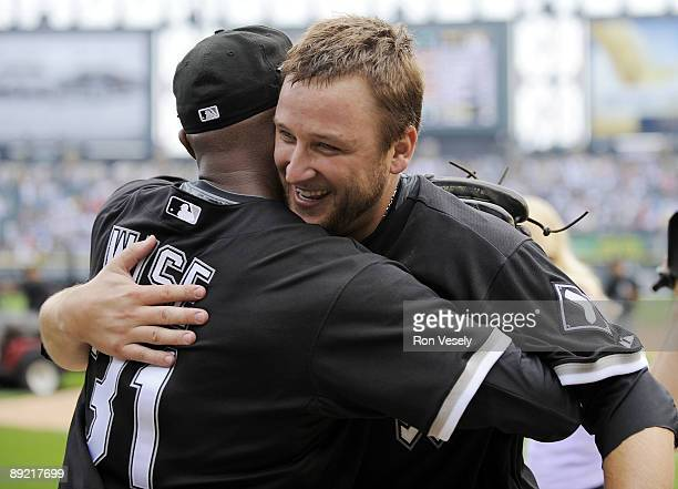 Mark Buehrle of the Chicago White Sox hugs outfielder DeWayne Wise who made a great catch in the ninth inning enabling Buehrle to record the 18th...