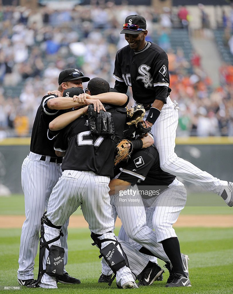 Mark Buehrle #56 of the Chicago White Sox is mobbed by teammates after Buehrle recorded the 18th perfect game in major league history against the Tampa Bay Rays on June 23, 2009 at U.S. Cellular Field in Chicago, Illinois. The White Sox defeated the Rays 5-0.