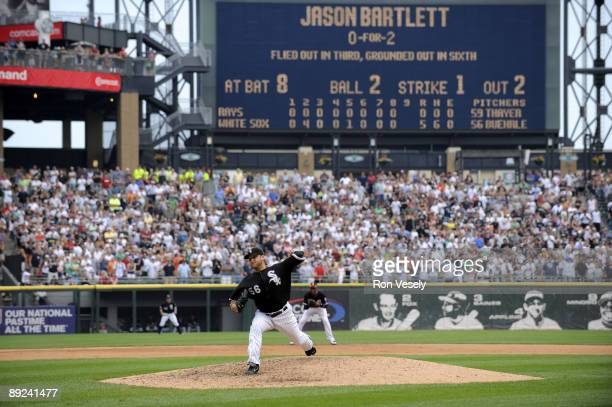 Mark Buehrle of the Chicago White Sox throws the final pitch of the game to Jason Bartlett to record the 18th perfect game in major league history...