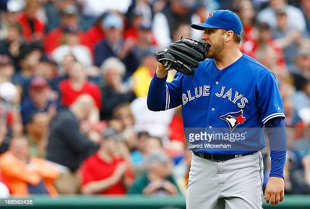 Mark Buehrle of the Toronto Blue Jays bites his glove before being pulled against the Boston Red Sox during the game on May 11 2013 at Fenway Park in...
