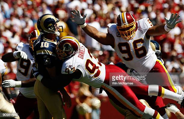 Mark Bulger of the St Louis Rams tries to avoid Phillip Daniels and Cornelius Griffin of the Washington Redskins during their game on September 20...