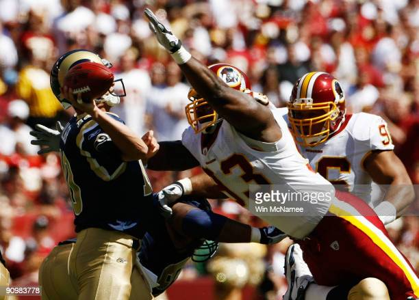Mark Bulger of the St Louis Rams tries to avoid Phillip Daniels of the Washington Redskins during their game on September 20 2009 at FedEx Field in...