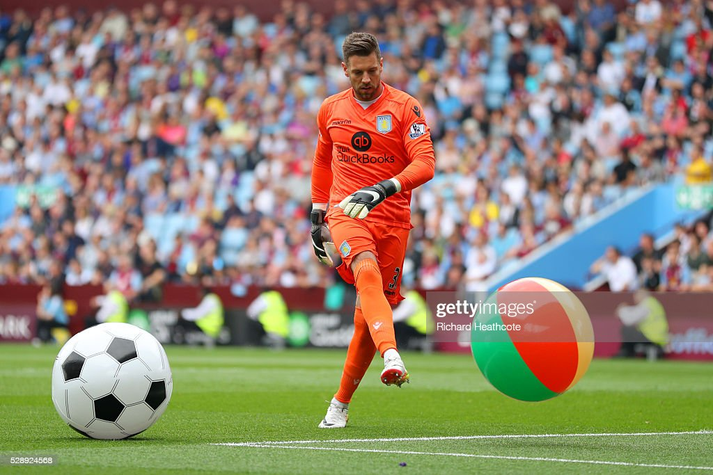 Mark Bunn of Aston Villa kicks balls during the Barclays Premier League match between Aston Villa and Newcastle United at Villa Park on May 7, 2016 in Birmingham, United Kingdom.
