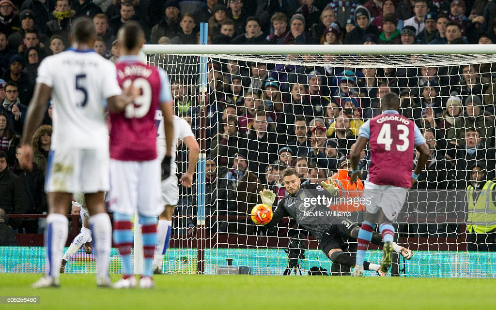 Mark Bunn of Aston Villa saves a penalty during the Barclays Premier League match between Aston Villa and Leicester City at Villa Park on January 16, 2016 in Birmingham, England.