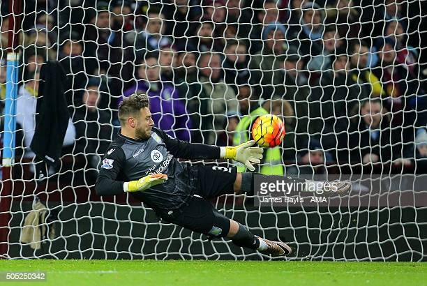 Mark Bunn of Aston Villa saves a penalty from Riyad Mahrez of Leicester City during the Barclays Premier League match between Aston Villa and...