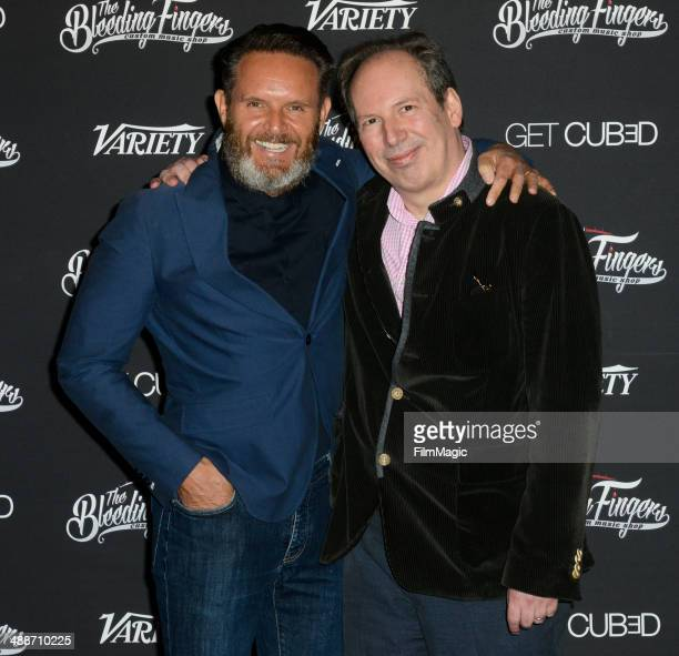 Mark Burnett and Hans Zimmer attend The Bleeding Fingers Custom Music Shop Launch Party on May 7 2014 in Los Angeles California