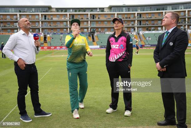 Mark Butcher and Match Referee Phil Whitticase oversee the coin toss between Suzie Bates of New Zealand and Dane Van Niekerk of South Africa during...