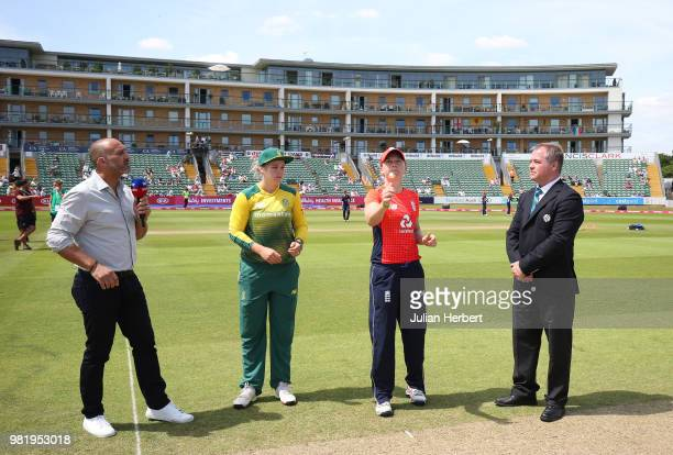 Mark Butcher and Match Referee Phil Whitticase oversee the coin toss by Heather Knight of England and Dan Van Niekerk of South Africa during the...