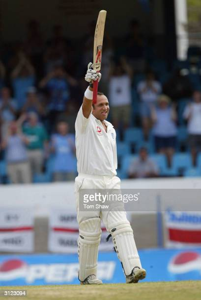 Mark Butcher of England celebrates scoring the winning runs during day 5 of the 2nd Test Match between the West Indies and England at Queens Park...