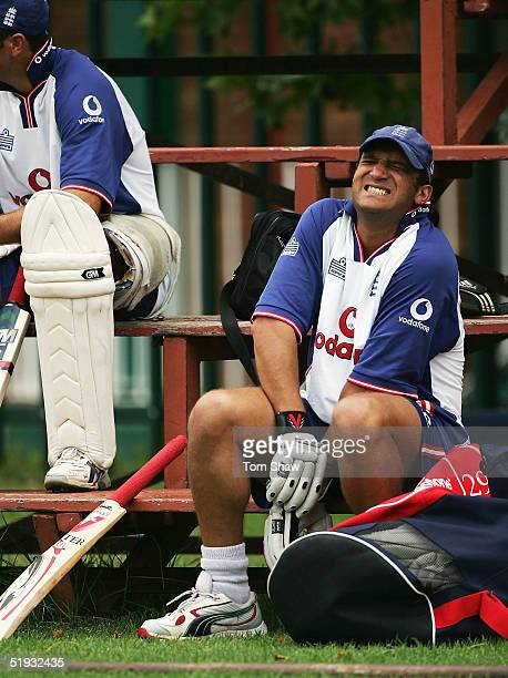 Mark Butcher of England grimaces in pain as he puts his gloves on during the England nets session on January 10, 2005 at the Wanderers Stadium,...