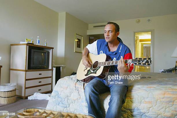 Mark Butcher of England plays his guitar at the Hilton Hotel, on March 24 in Port of Spain, Trinidad. Photo by Tom Shaw/Getty Images)