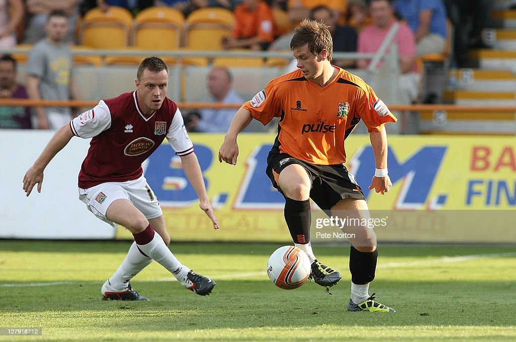 Mark Byrne of Barnet controls the ball watched by Paul Turnbull of Northampton Town during the npower League two match between Barnet and Northampton Town at Underhill Stadium on October 1, 2011 in Barnet, England.