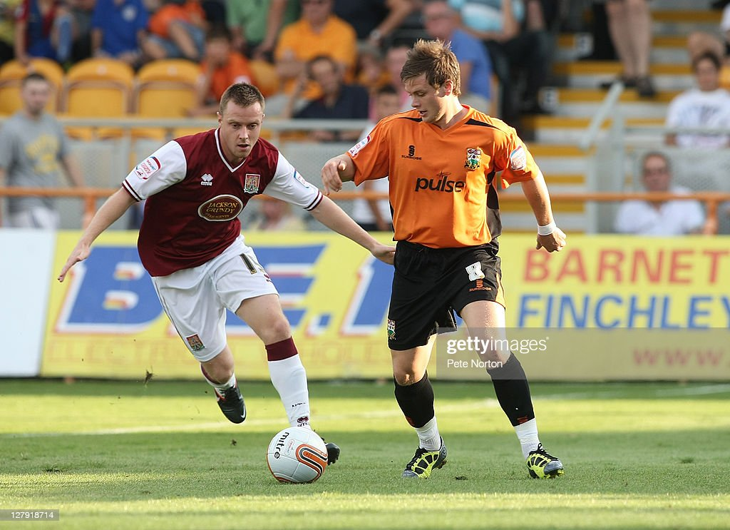 Mark Byrne of Barnet looks to control the ball watched by Paul Turnbull of Northampton Town during the npower League two match between Barnet and Northampton Town at Underhill Stadium on October 1, 2011 in Barnet, England.