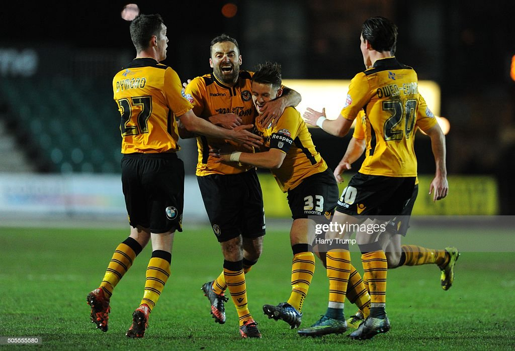 Mark Byrne of Newport County (C) celebrates his sides first goal during the Emirates FA Cup Third Round match between Newport County and Blackburn Rovers at Rodney Parade on January 18, 2016 in Newport, Wales.