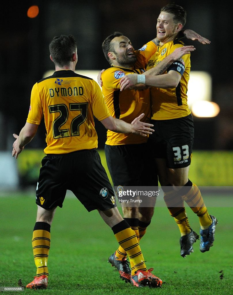 Mark Byrne of Newport County (R) celebrates his sides first goal during the Emirates FA Cup Third Round match between Newport County and Blackburn Rovers at Rodney Parade on January 18, 2016 in Newport, Wales.