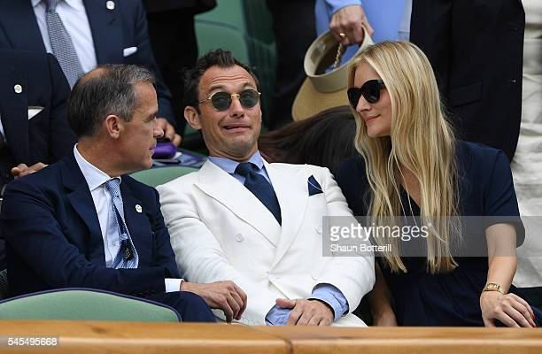 Mark Cairney Jude Law and Phillipa Coan watch on as Roger Federer of Switzerland plays Milos Raonic of Canada in the Men's Singles Semi Final match...