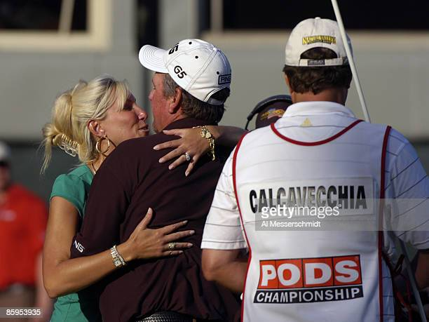 Mark Calcavecchia and his wife Brenda celebrate as Mark's caddie Eric Larson watches on the 18th green during the final round of the PODS...