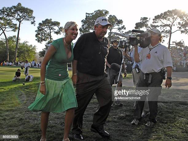 Mark Calcavecchia and his wife Brenda leave the 18th hole awards ceremony during the final round of the PODS Championship at Innisbrook Resort and...