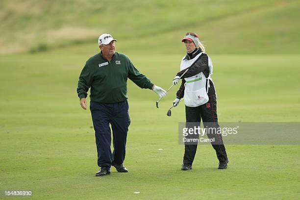 Mark Calcavecchia and wife Brenda exchange clubs in the first fairway during the second round of the 2012 ATT Championship at the Canyons Course at...