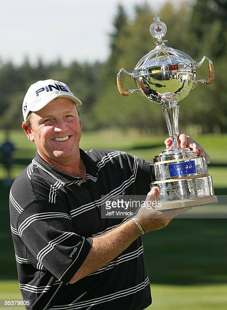 Mark Calcavecchia holds the Bell Canadian Open trophy September 11, 2005 in Vancouver, British Columbia. Calcavecchia snapped a four-year winless...