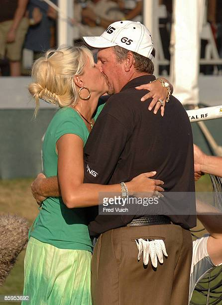 Mark Calcavecchia kisses his wife after winning the PODS Championship held on the Copperhead Course at Innisbrook Resort Golf Club in Palm Harbor...