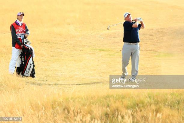 Mark Calcavecchia of the United States hits his second shot on the first hole alongside wife and caddie Brenda Calcavecchia during the first round of...