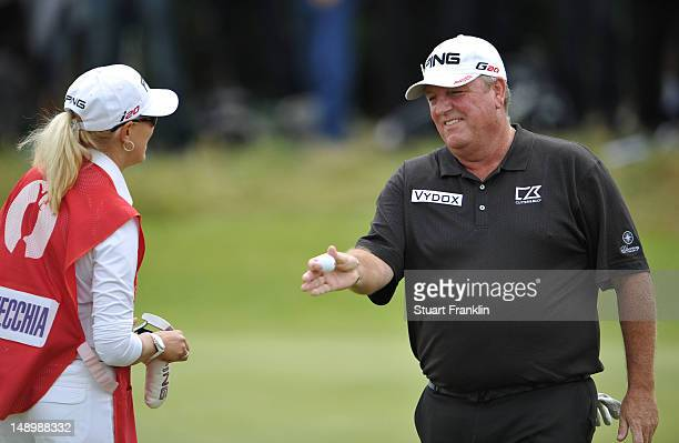 Mark Calcavecchia of the United States speaks with his wife and caddie Brenda Calcavecchia during the third round of the 141st Open Championship at...