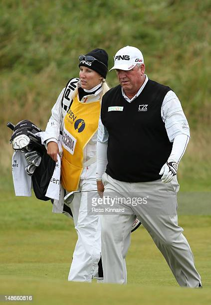 Mark Calcavecchia of the United States walks down the fourth hole with caddies Brenda Calcavecchia during the first round of the 141st Open...