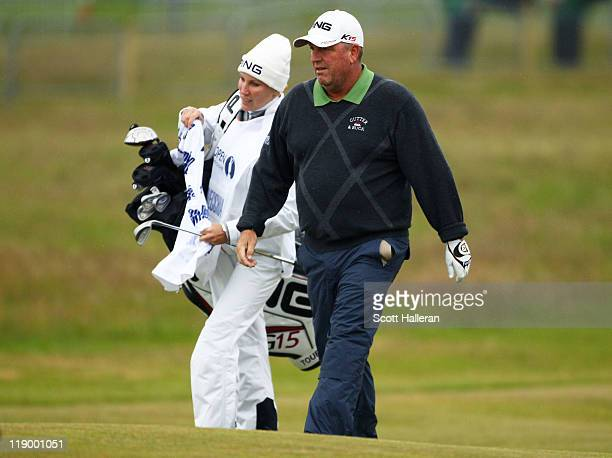 Mark Calcavecchia of the United States walks with caddie and wife Brenda during the first round of The 140th Open Championship at Royal St George's...