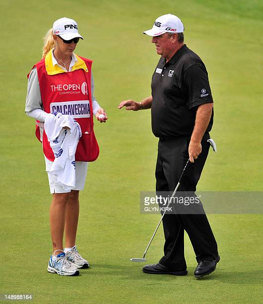 Mark Calcavecchia of the US talks with wife and caddie Brenda on the 2nd green during his third round on day three of the 2012 British Open Golf...