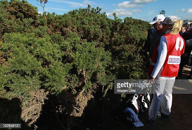 Mark Calcavecchia of the USA and his wife and caddie Brenda Calcavecchia look for his ball in a gorse bush on the fifth hole during the third round...