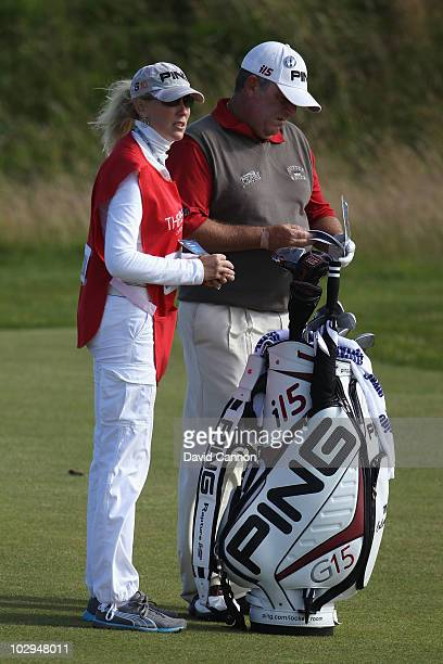 Mark Calcavecchia of the USA and his wife and caddie Brenda Calcavecchia on the fifth hole during the third round of the 139th Open Championship on...
