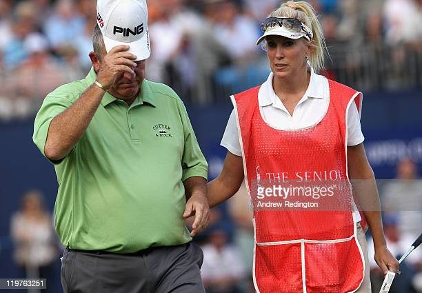 Mark Calcavecchia of the USA is consoled by his wife/caddie Brenda on the 18th green during the final round of the Senior Open Championship at Walton...