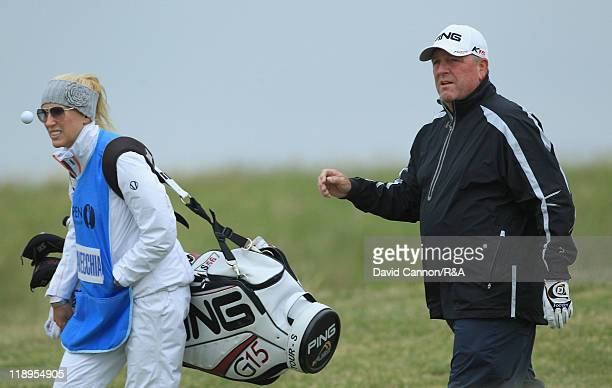 Mark Calcavecchia of the USA walks with his wife/caddie Brenda during the final practice round during The Open Championship at Royal St George's on...