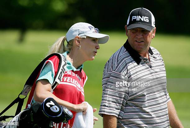 Mark Calcavecchia of USA and his new wife Brenda Calcavecchia on the second hole during the second round of The Telecom Italian Open Golf at The...