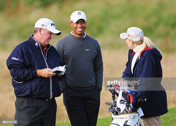 Mark Calcavecchia of USA chats with his wife/caddy Brenda and Tiger Woods of USA during a practice round prior to the 138th Open Championship on July...