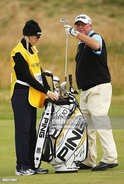 Mark Calcavecchia of USA pulls a club as his wife/caddy Brenda looks on during round two of the 138th Open Championship on the Ailsa Course Turnberry...