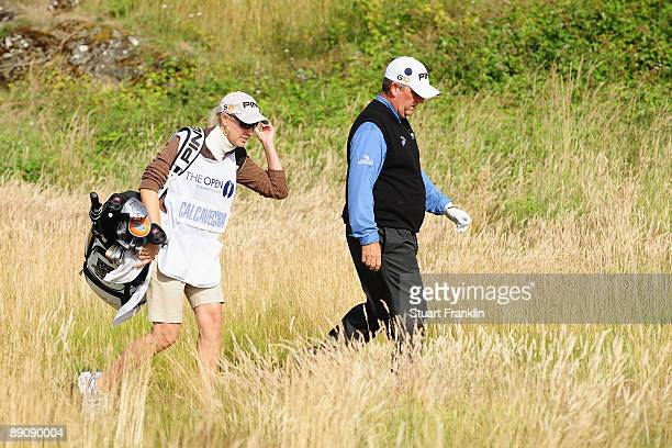 Mark Calcavecchia of USA walks with his wife/caddie Brenda during round three of the 138th Open Championship on the Ailsa Course Turnberry Golf Club...