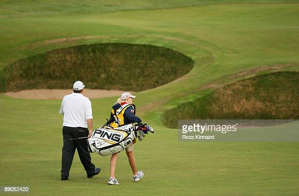 Mark Calcavecchia of USA walks with his wife/caddy Brenda to the 5th green during round one of the 138th Open Championship on the Ailsa Course...