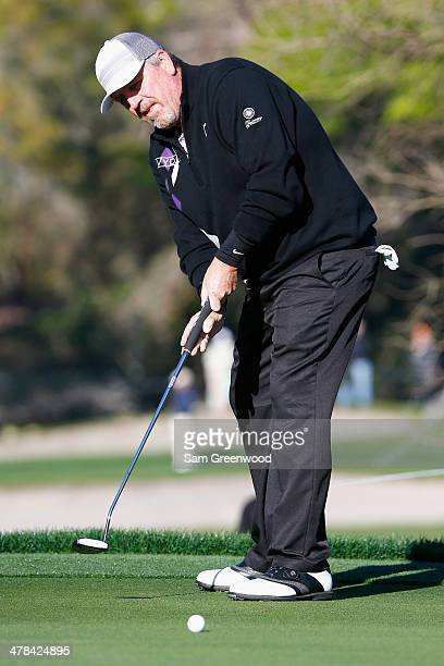 Mark Calcavecchia watches a birdie putt on the 16th green during the first round of the Valspar Championship at Innisbrook Resort and Golf Club on...